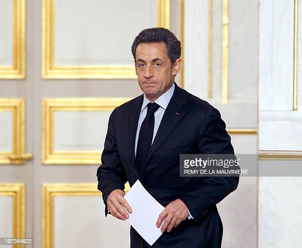 French President Nicolas Sarkozy arrives to give a speech at the end of a crisis summit with unions representatives at the Elysee Palace in Paris on...