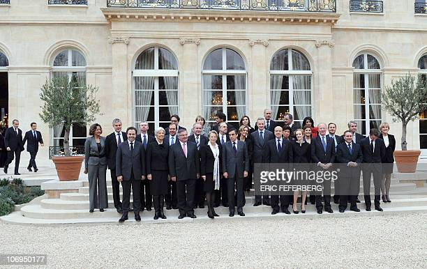 French President Nicolas Sarkozy arrives to pose with Prime Minister Francois Fillon and members of the newly reshuffled French government for a...