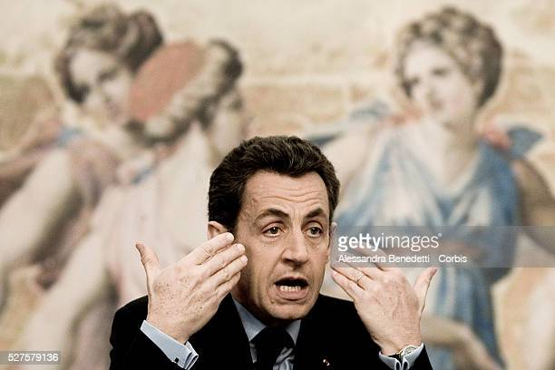 French President Nicolas Sarkozy attends a joint press conference with Italian Prime Minister Silvio Berlusconi after having signed an agreement in...