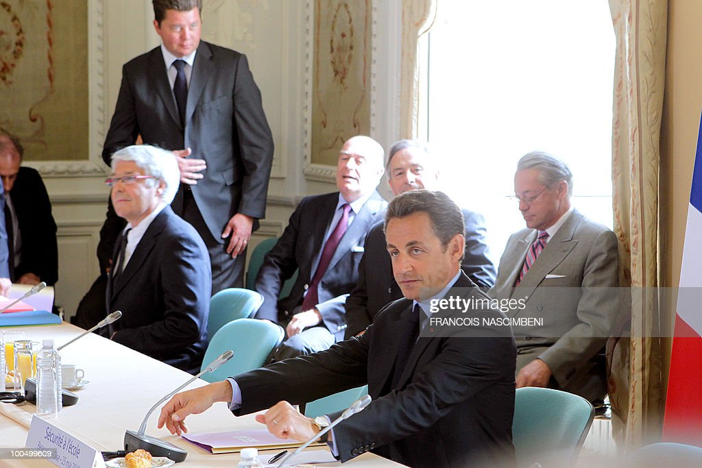 French President Nicolas Sarkozy (2nd R) attends a meeting on school violences and truancy, on May 25, 2010 in Beauvais, northern France.