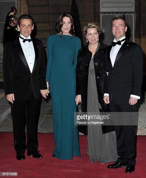 French President Nicolas Sarkozy Carla BruniSarkozy Svetlana Medvedeva and Russian President Dmitry Medvedev pose as they arrive to attend a state...
