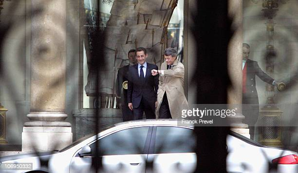 French President Nicolas Sarkozy chats with his outgoing centreright Minister for Ecology Jean Louis Borloo as he leaves after a meeting at Elysee...