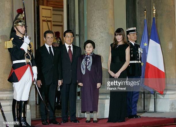 French President Nicolas Sarkozy Chinese President Hu Jintao Chinese First Lady Liu Yongqing and French First Lady Carla Bruni Sarkozy at a state...