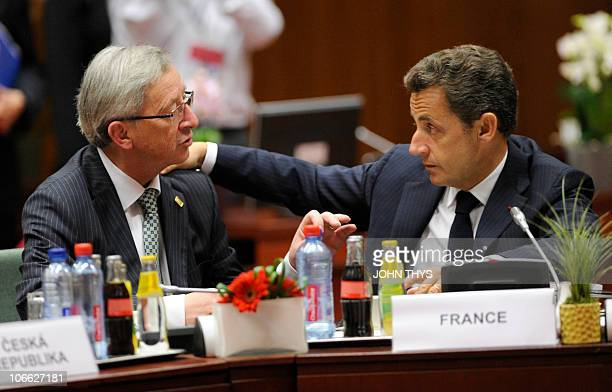 French President Nicolas Sarkozy confer with Luxembourg Prime Minister JeanClaude Juncker prior to a working session of a European Union summit on...