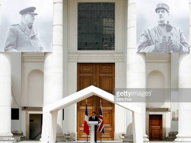 French President Nicolas Sarkozy delivers a speech during his visit to the Royal Hospital Chelsea as he is surrounded by images of Britain's World...