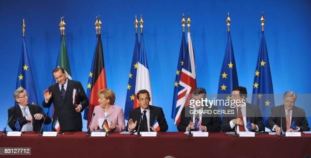 French President Nicolas Sarkozy flanked by Luxemburg's Prime Minister JeanClaude Junker Italian Prime Minister Silvio Berlusconi German chancellor...