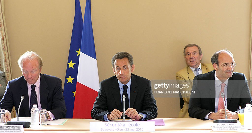 French President Nicolas Sarkozy (C), French Interior minister Brice Hortefeux (L) and French Labour, Social Relations and Solidarity minister Eric Woerth (R), attend a meeting on school violences and truancy, on May 25, 2010 in Beauvais, northern France.
