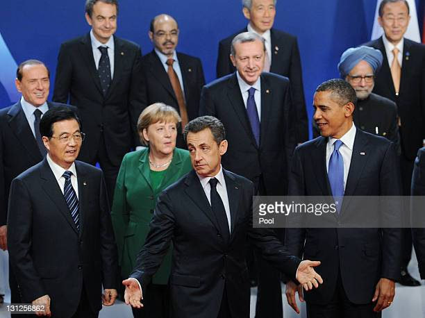 French President Nicolas Sarkozy gestures as German Changellor Angela Merkel USPresident Barack Obama and China Prime Minister Hu Jintao pose for a...