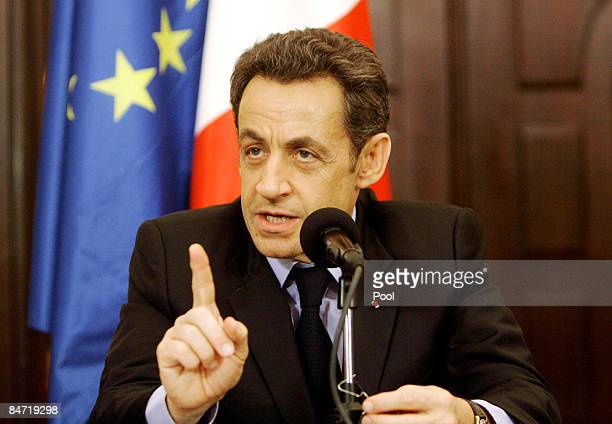 French President Nicolas Sarkozy gestures during a joint press conference with Iraqi President Jalal Talabani on February 10 2009 in Baghdad Iraq...