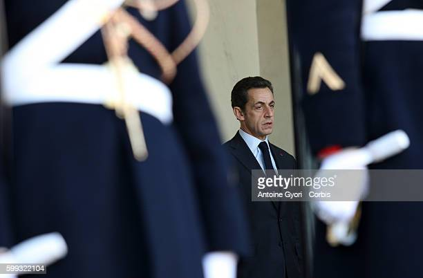 French President Nicolas Sarkozy gets ready to welcome heads of state prior to the start of a meeting between the representatives of the Central...