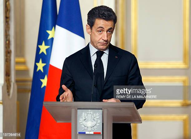 French President Nicolas Sarkozy gives a speech at the end of a crisis summit with unions representatives at the Elysee Palace in Paris on January 18...