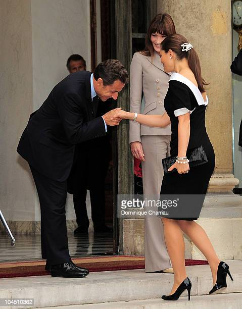 French President Nicolas Sarkozy greets Crown Princess Victoria of Sweden as Carla BruniSarkozy stand in the courtyard of Elysee Palace at on...