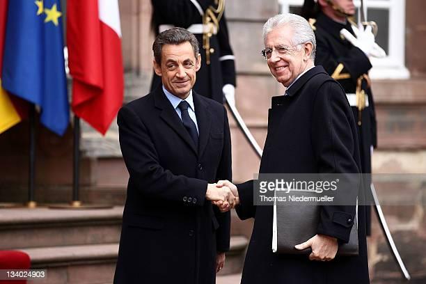 French President Nicolas Sarkozy greets Italian Prime Minister Mario Monti prior to a meeting with German Chancellor Angela Merkel on November 24,...