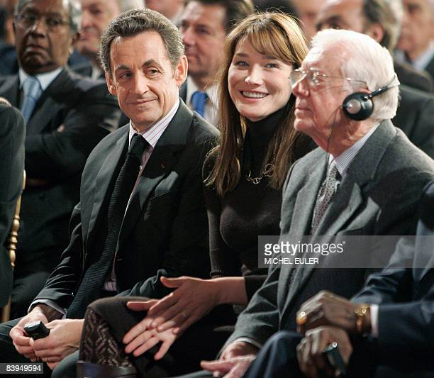 French President Nicolas Sarkozy his wife Carla BruniSarkozy and former US President Jimmy Carter attends a ceremony marking the 60th anniversary of...
