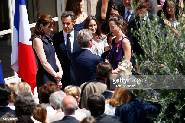 French President Nicolas Sarkozy, his wife Carla Bruni-Sarkozy , Bernard Kouchner and Ingrid Betancourt stand together after the decoration ceremony...