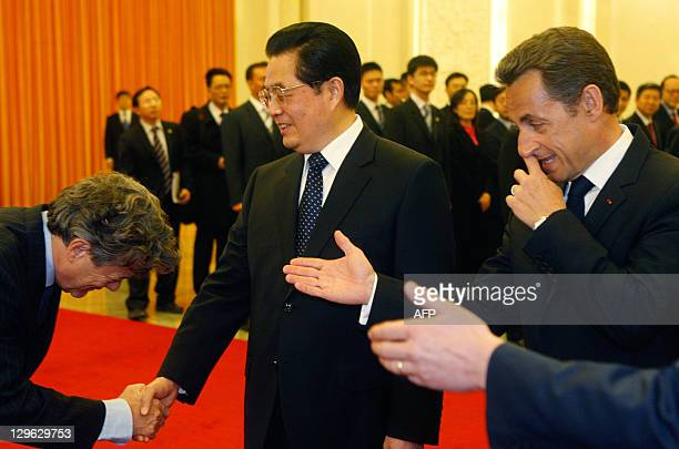 French President Nicolas Sarkozy introduces French Ecology Minister Jean-Louis Borloo to Chinese President Hu Jintao during a welcome ceremony at the...