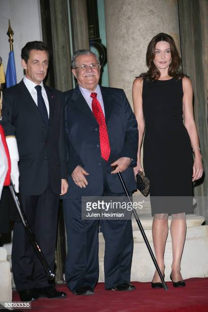 French president Nicolas Sarkozy Iraq president Jalil Talabani and Carla BruniSarkozy attend the dinner honoring Iraq President Jalil Talabani at...