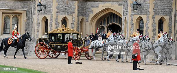 French President Nicolas Sarkozy is accompaned by Queen Elizabeth II in a carriage procession to Windsor Castle on the first day of his State Visit...