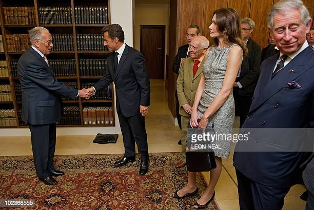 French President Nicolas Sarkozy, is greeted as he and his wife Carla Bruni-Sarkozy , along with Britain's Prince Charles arrive to look at...