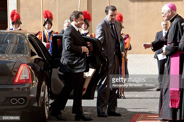French President Nicolas Sarkozy is received by Archbishop James Michael Harvey at the San Damaso courtyard prior a meeting with Pope Benedict XVI at...