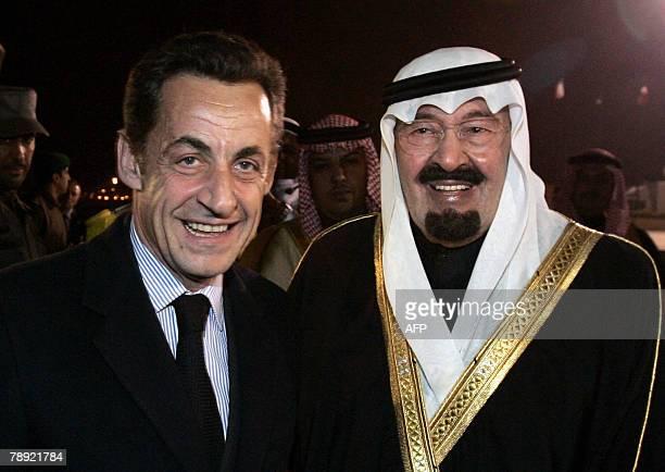 French President Nicolas Sarkozy is welcomed by Saudi Arabia's King Abdullah bin Abd Al Aziz Al Saud upon his arrival at Riyadh airport for a twoday...