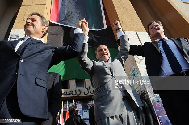 French President Nicolas Sarkozy leader of Libya's interim government Mustafa AbdulJalil and Prime Minister David Cameron meet the locals in Benghazi...