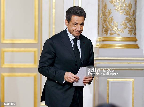 French President Nicolas Sarkozy leaves after giving a speech at the end of a crisis summit with unions representatives at the Elysee Palace in Paris...