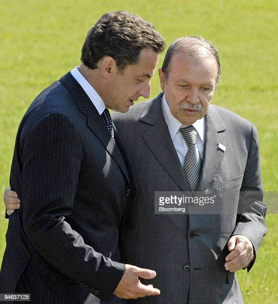 French President Nicolas Sarkozy left talks with Algerian President Abdelaziz Bouteflika at the summit in Heiligendamm Germany Friday June 8 2007...
