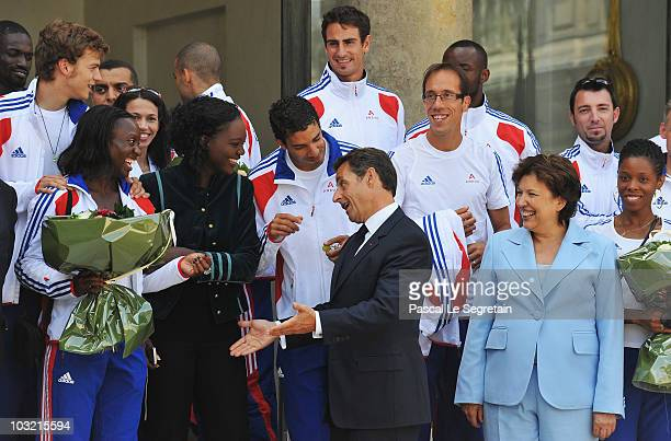 French President Nicolas Sarkozy , Minister for Health and Sports Roselyne Bachelot-Narquin and France's Junior Minister for Sports, Rama Yade pose...