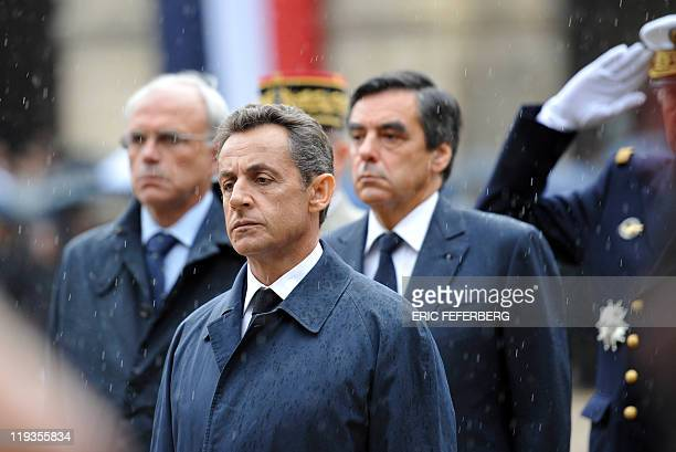 French President Nicolas Sarkozy Prime minister François Fillon and Junior minister for Defence Marc Laffineur pay their respect in the Invalides...