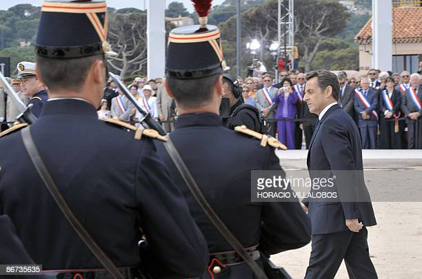 French President Nicolas Sarkozy reviews the troops during a ceremony to commemorate armistice day on May 8 the 64th anniversary of the Allied...