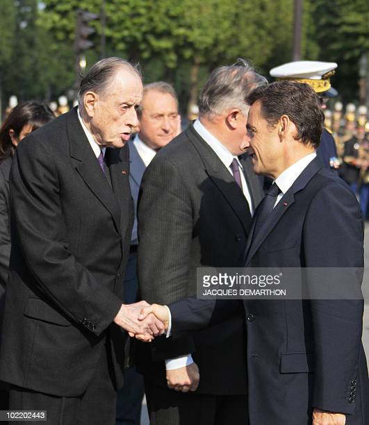 French President Nicolas Sarkozy shake hands with General de Gaulle' son Philippe de Gaulle on June 18 2010 during a ceremony in Paris as part of the...