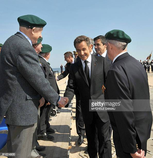 French President Nicolas Sarkozy shakes hand with members of Kieffer commando on May 8 2008 as part of ceremonies commemorating the armistice of May...