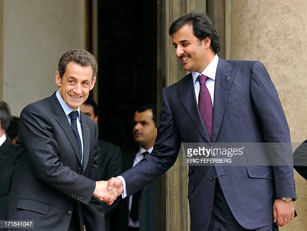 French President Nicolas Sarkozy shakes hand with Qatar Crown Prince Sheikh Tamim Bin Hamad Al Thani on February 3 2010 at the Elysee Palace in Paris...