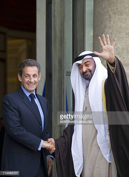 French President Nicolas Sarkozy shakes hand with Sheikh Mohammed bin Zayed Al Nahyan Crown Prince of Abu Dhabi and Deputy Supreme Commander of the...