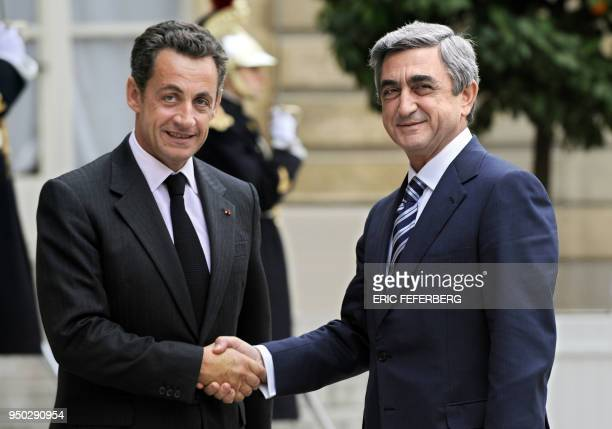 French President Nicolas Sarkozy shakes hands with Armenian Prime Minister Serzh Sarkisian 26 October 2007 at the presidential Elysee Palace in Paris...