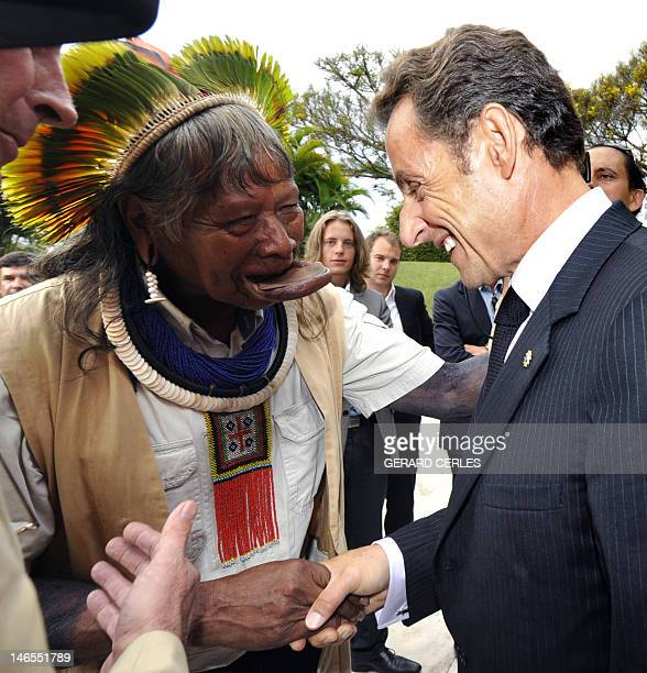 French President Nicolas Sarkozy shakes hands with chief Raoni Metyktire in the French embassy in Brasilia at the end of the Brazilian Independency...
