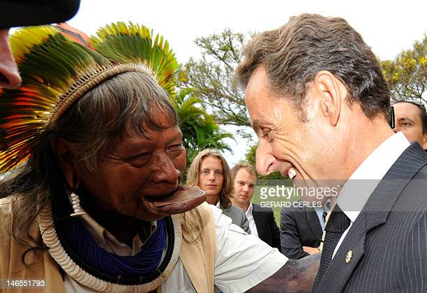 French President Nicolas Sarkozy shakes hands with chief Raoni Metuktire in the French embassy in Brasilia at the end of the Brazilian Independency...