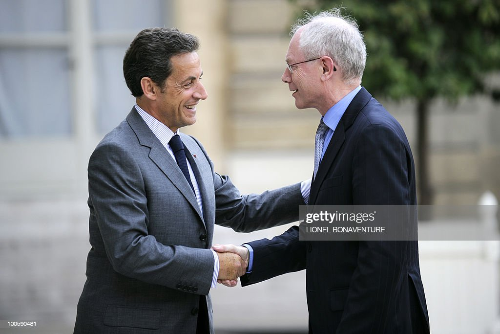French President Nicolas Sarkozy (L) shakes hands with European Union President Herman Van Rompuy, prior to a meeting on May 25, 2010 at the Elysee Palace in Paris.