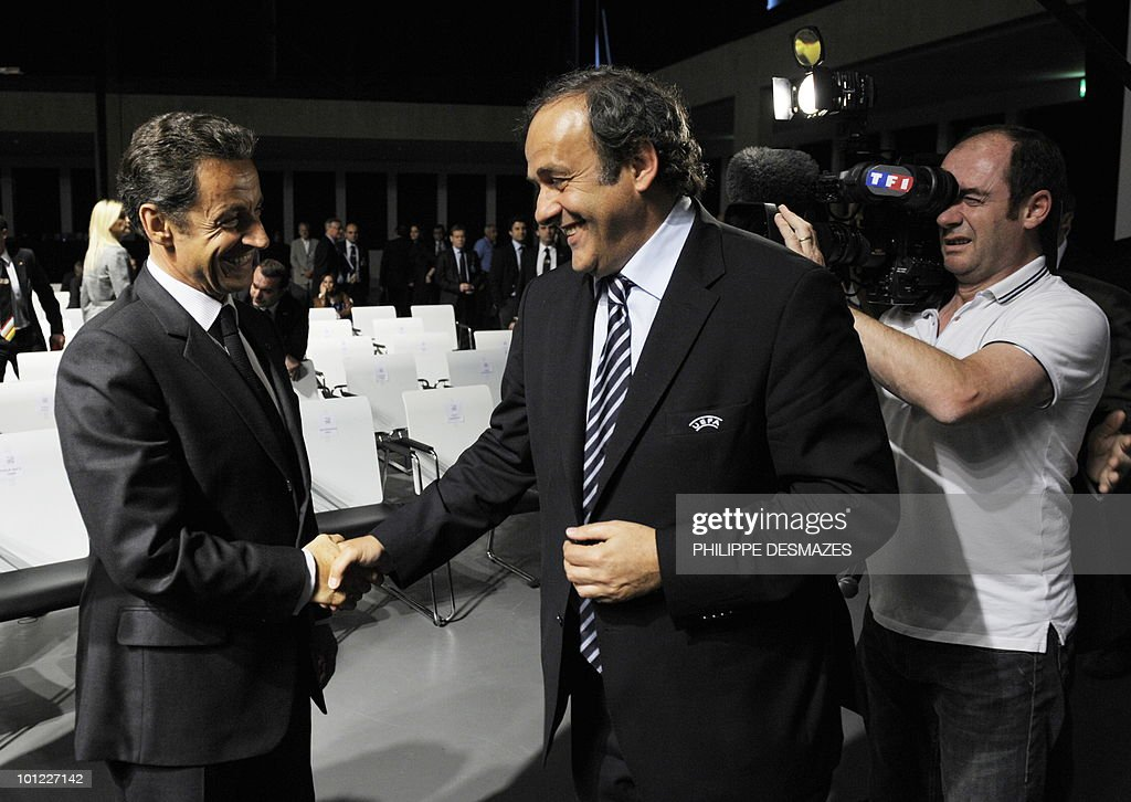 French President Nicolas Sarkozy (L) shakes hands with French President of UEFA Michel Platini after he announced that France were named as hosts of the Euro 2016 football tournament at the UEFA headquarters in Geneva.