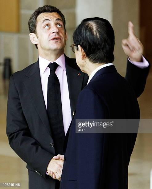 French President Nicolas Sarkozy shakes hands with Japanese Prime Minister Yasuo Fukuda upon arriving at the Windsor Hotel Toya on July 7 2008 in...