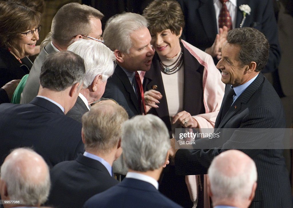 French President Nicolas Sarkozy shakes hands with members after speaking to a joint meeting of Congress on Wednesday, Nov. 7, 2007.