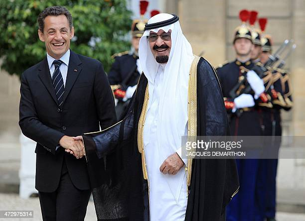 French President Nicolas Sarkozy shakes hands with Saudi King Abdullah bin Abdul Aziz alSaud prior to a meeting at the Elysee palace in Paris 21 June...