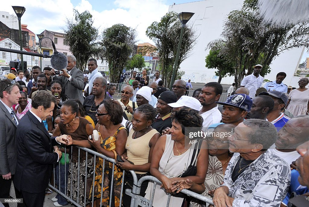 French president Nicolas Sarkozy (L) shakes hands with wellwishers on February 18, 2010 in Fort-de-France, as part of his travel to the French overseas departments of Martinique and French Guiana. AFP PHOTO / POOL / Philippe Wojazer
