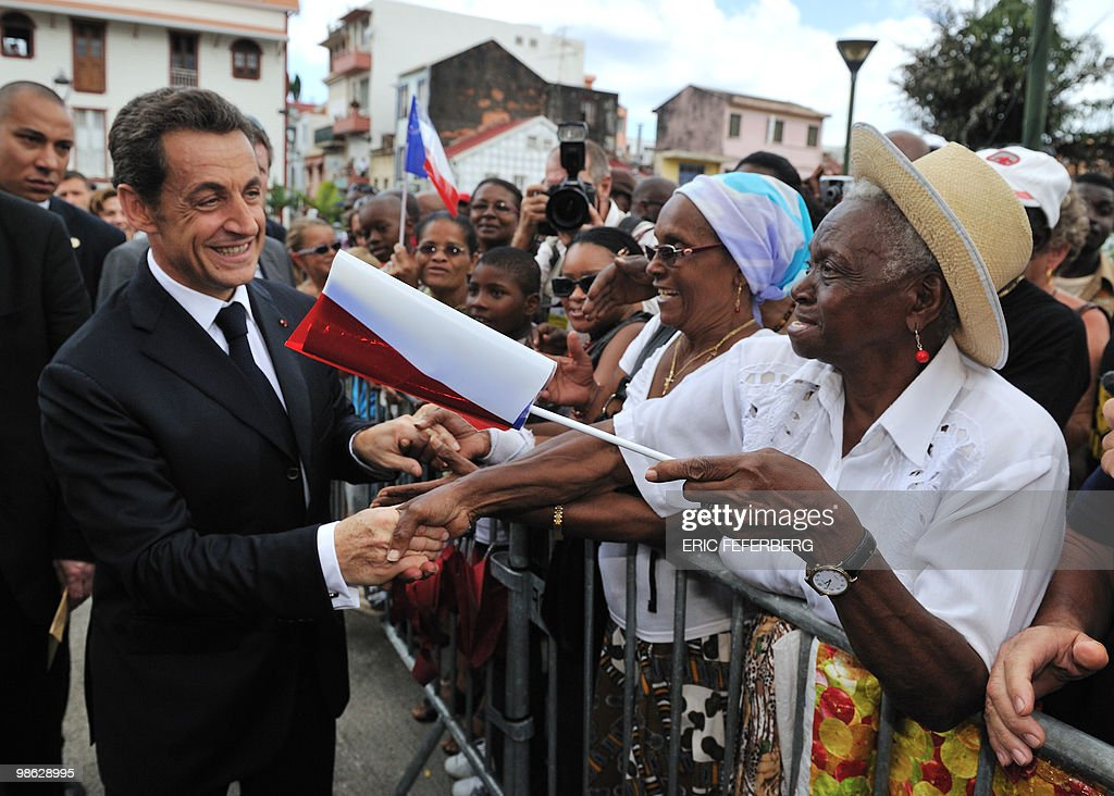 French president Nicolas Sarkozy (L) shakes hands with wellwishers on February 18, 2010 in Fort-de-France, as part of his travel to the French overseas departments of Martinique and French Guiana.