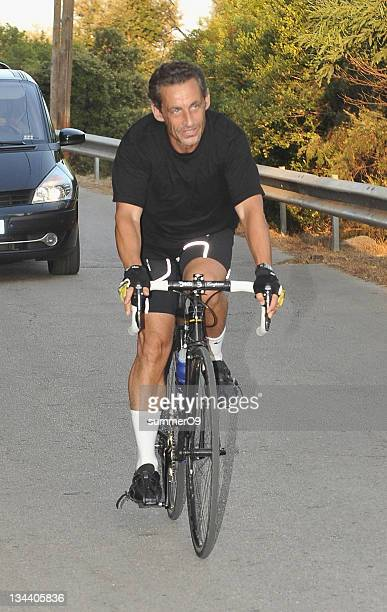 French president Nicolas Sarkozy sighted while cycling on August 21 2009 at Le Cap Negre near Le Lavandou France