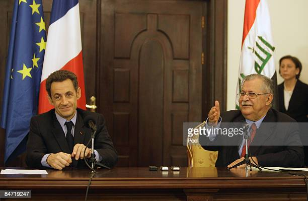 French President Nicolas Sarkozy smiles as he attends a joint press conference with Iraqi President Jalal Talabani on February 10 2009 in Baghdad...