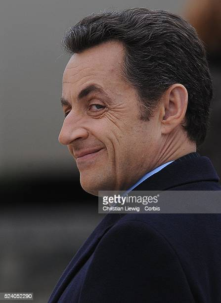 French President Nicolas Sarkozy smiles during the ceremony held in memory of French soldiers who served during World War I at the Invalides Paris...