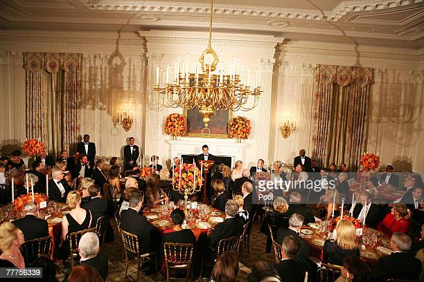 French President Nicolas Sarkozy speaks at a social dinner in the State Dining Room of the White House November 6, 2007 in Washington DC. The dinner...