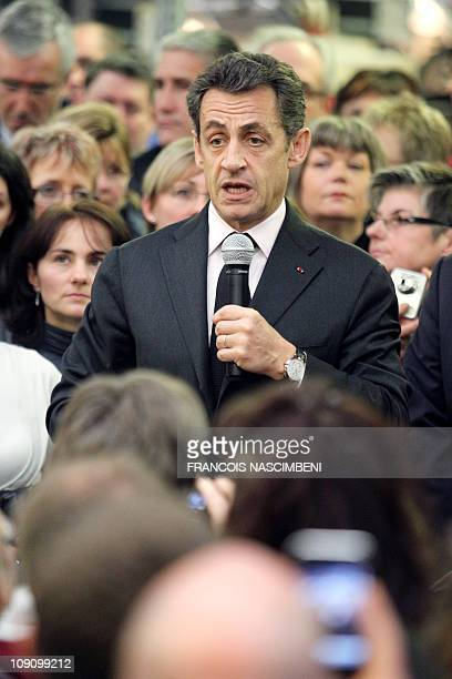 French President Nicolas Sarkozy speaks during a tour of an Axon Cable factory which produces high tech cables on February 15 2011 in Montmirail...